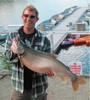 While jigging for trout with 6-pound test line, Hughes caught this 20-pound mackinaw at Wallowa Lake during the Summer Fishtrap Writers' Gathering, 2011.