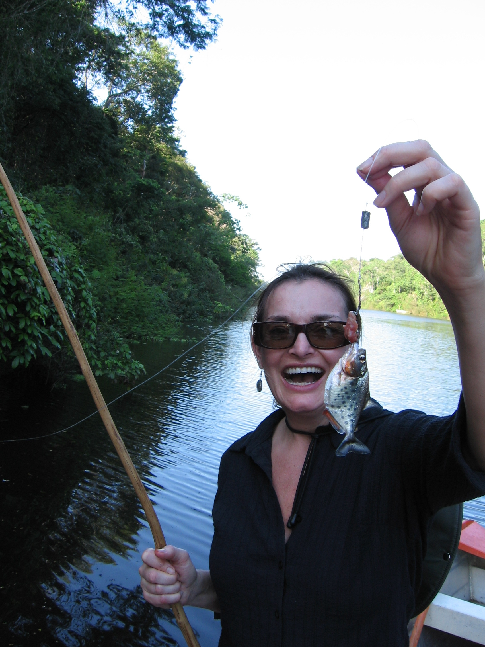 Chloe Hughes catching piranha in the Amazon River, Peru, 2008.