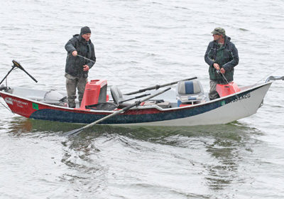 Henry Hughes (right) casts with Craig Schuhmann, editor of Flyfishing & Tying Journal, during the Northwest Outdoor Writer's fishing derby on Diamond Lake, April 29, 2016.  Photo by Dennis Kirkland