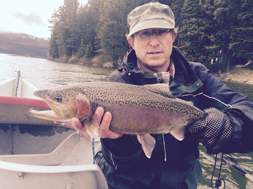 "Hughes won the Northwest Outdoor Writer's fishing derby with this 24"" rainbow caught on a spinner.  Photo by Dennis Kirkland"
