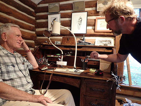 Talking with Tom McGuane over his tying desk, September, 2018. Photo by Chloe Hughes.